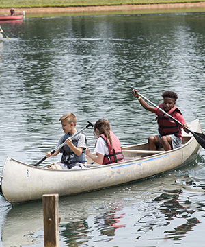 Kids canoeing at 4-H camp
