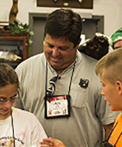 Camp counselor talking with kids